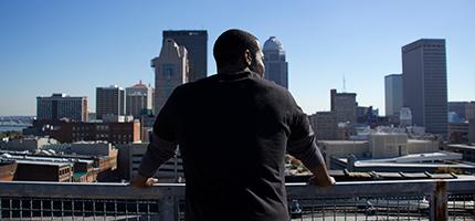 Bryen Pinkard overlooking Louisville, Kentucky from Glassworks rooftop